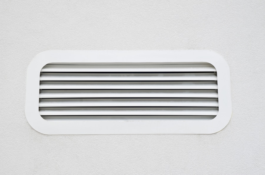 New white air conditioning vent on wall closeup in Birmingham, AL