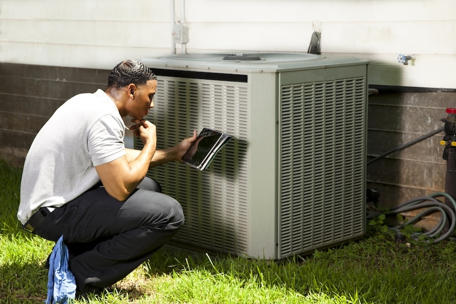 air-conditioner-technician-outside